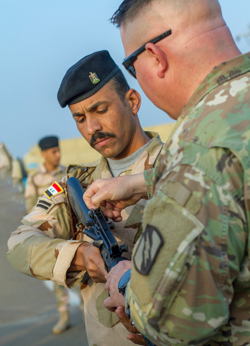 SFC Michael Garner (right) of the 2nd Battalion, 114th Field Artillery Regiment, 155th Armored Brigade Combat Team, Mississippi Army National Guard and Task Force India Bravo, instructs an Iraqi soldier during a primary marksmanship course led by the task force at Camp Taji, Iraq. Mississippi Army National Guard photo by SPC Jovi Prevot