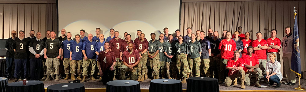 Participants of the 2019 Polyglot Games gather for a photo at the closing of the games held in Draper, Utah, as part of the 300th Military Intelligence Brigade's 30th Annual Language Conference. National Guard Bureau photo by Luke Sohl