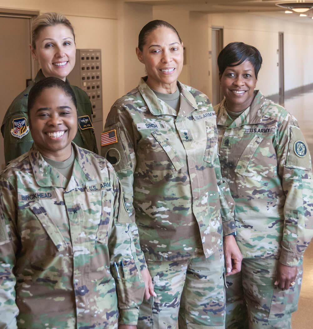 Left to Right: BG Janeen Birckhead, Brig Gen April Vogel, MG Linda Singh, CSM Perlisa Wilson. National Guard Bureau photo by Luke Sohl