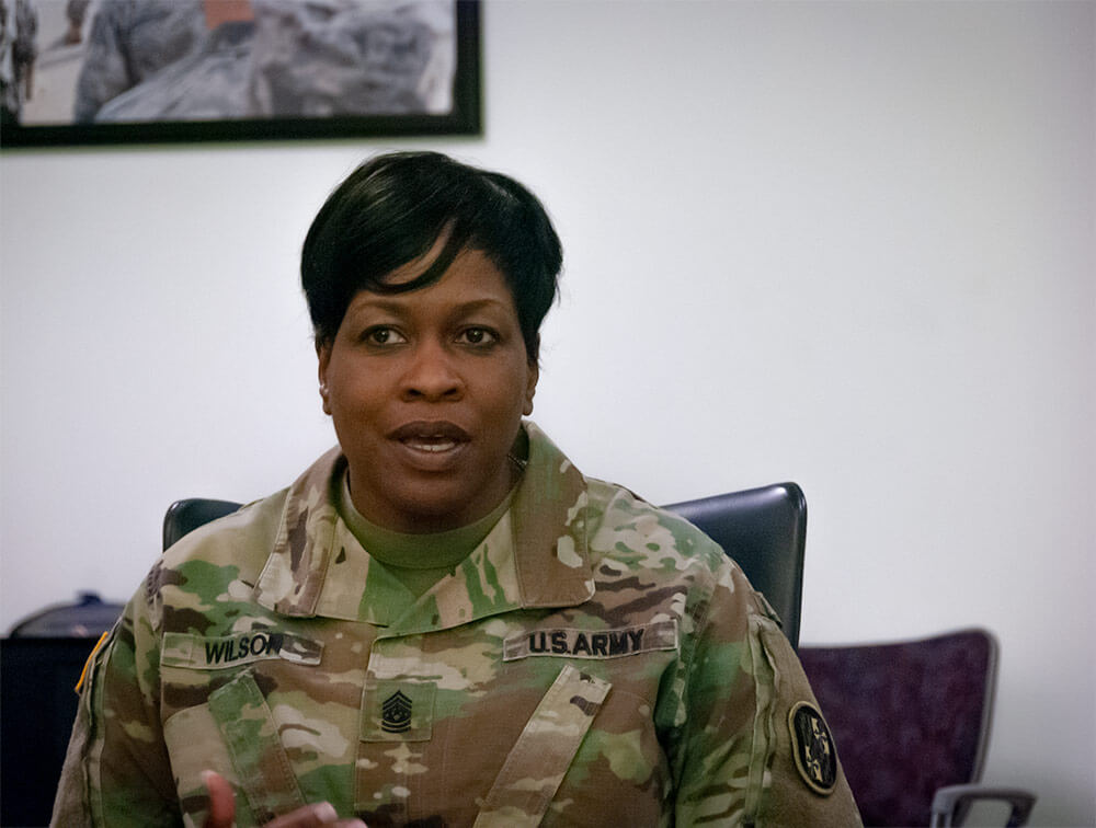 CSM Perlisa Wilson addresses reporters during a Pentagon press conference acknowledging the all-female command team. National Guard Bureau photo by Luke Sohl