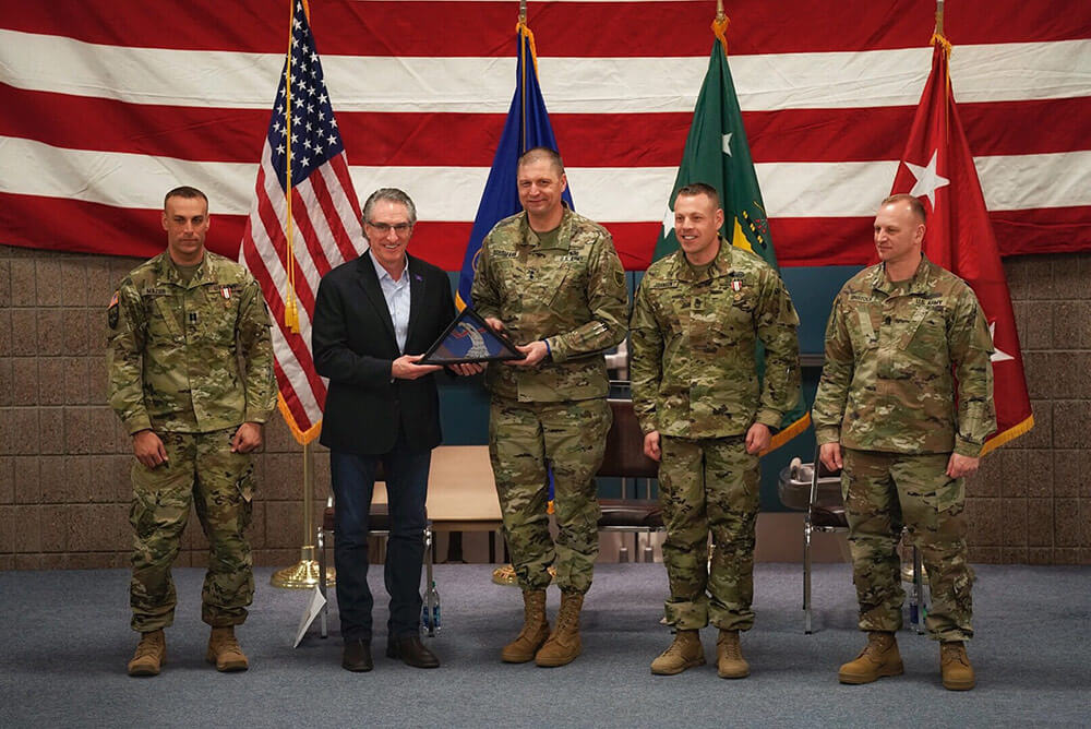 From Left to Right: CPT John Mazur, N.D. Governor Doug Burgum, N.D. Adjutant General MG Al Dohrmann, MSG Cody Johnson and CSM Eric Binstock, N.D. National Guard senior enlisted leader, are shown as Burgum is presented a North Dakota flag February 2019 brought back from Afghanistan by members of the 191st Military Police Company during a welcome home ceremony in Fargo, N.D. North Dakota Army National Guard photo by SSG Brett J. Miller