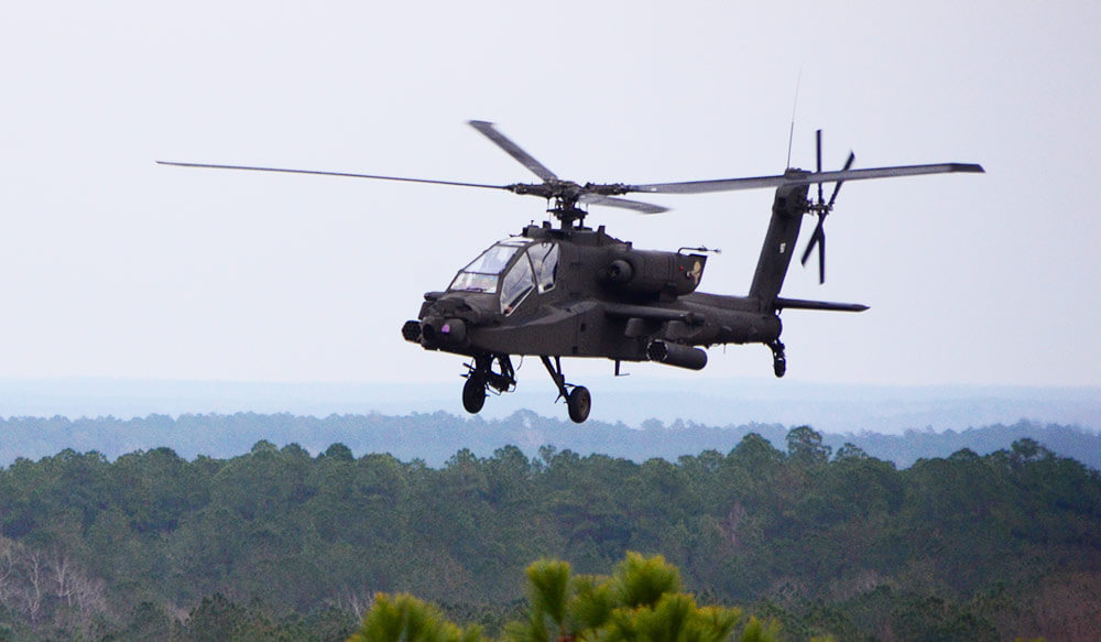 An Apache AH-64 crew flies enroute while coordinating targets with joint terminal attack controllers from the 148th Air Force Special Operations Command during the Southern Strike 19 training exercise. Mississippi National Guard photo by MSgt Edward Staton