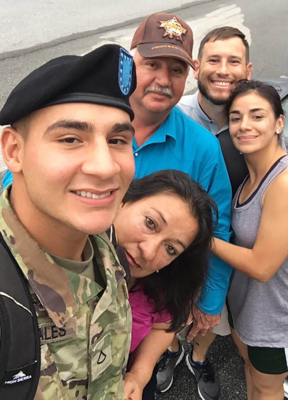 Then-PFC Efrain Morales takes a selfie with his mother, father Efrain Morales Sr., sister and brother-in-law after his boot camp graduation. Photo courtesy SPC Efrain Morales