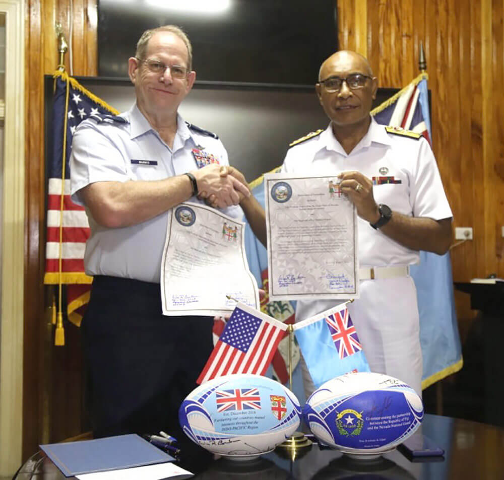 Adjutant General for the State of Nevada Brig Gen William R. Burks (left) and the Commander of the Republic of Fiji Military Forces Rear Adm. Viliame Naupoto display the signed official paperwork entering the island country into the National Guard State Partnership Program as partners with Nevada. Photo courtesy Nevada National Guard