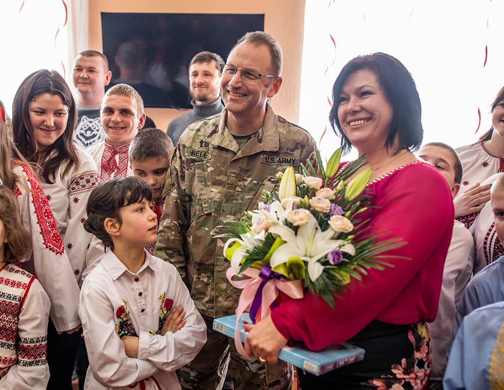 Tennessee Army National Guard Soldier MAJ Terry Bell greets director of the Rehabilitation Center for the Children of Special Needs Natalia Frankiv during a visit to the orphanage in Krakovets, Ukraine, March 2019. Tennessee Army National Guard photo by SGT Timothy Massey