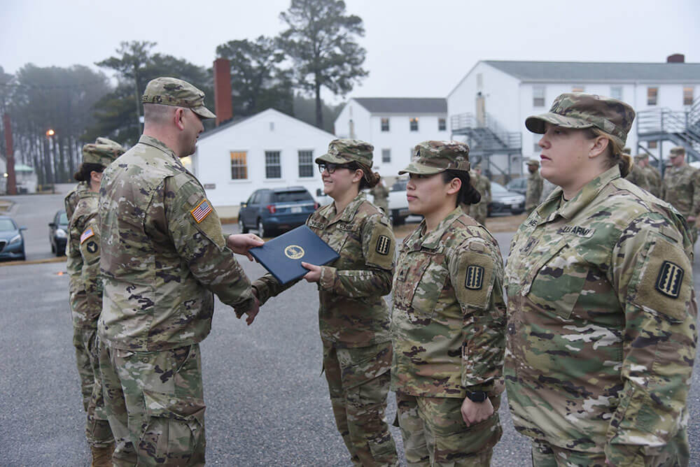 SFC Michelle Homer, SGT Christina So and SGT Gella Johnson receive recognition during a ceremony held March 2019, at Fort Pickett, Va., for saving the life of SFC Anthony Johnson. Virginia Army National Guard photo by SFC Terra Gatti