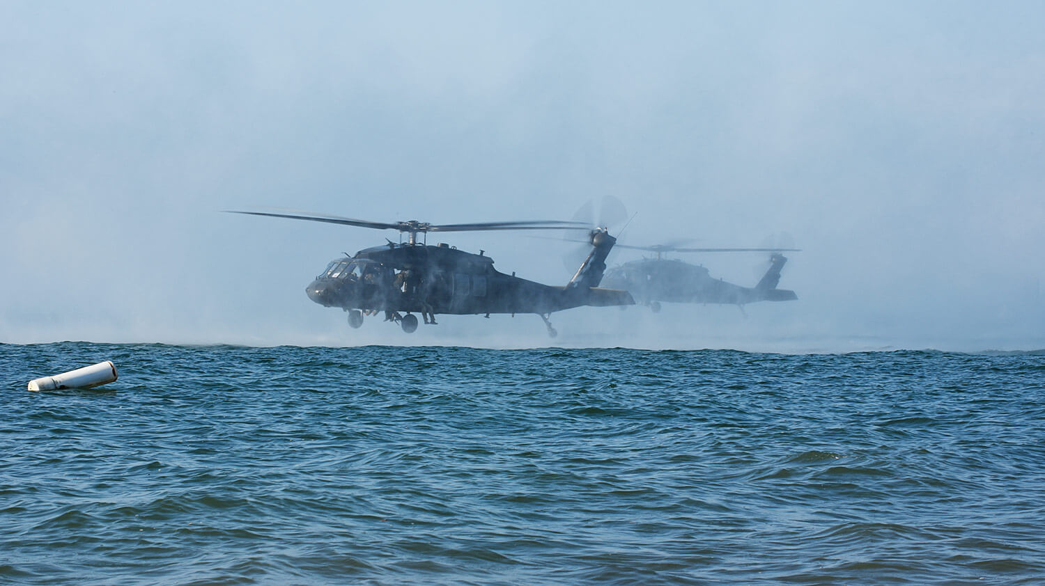 Virginia National Guard flight crews provide aviation support to Soldiers assigned to the West Virginia National Guard's 19th Special Forces Group, Sept. 5, 2018, over Lake Erie in Hamburg, N.Y., just south of Buffalo. The flight crews, assigned to the Sandston-based 2nd Battalion, 224th Aviation Regiment, 29th Infantry Division, dropped operators into the lake as part of an evaluation and pre-deployment train-up while boats from the Hamburg Water Rescue, Hamburg Police Department, U.S. Coast Guard and Department of Homeland Security worked together to retrieve the troops and return to the dry land. Virginia Army National Guard photo by SFC Terra C. Gatti