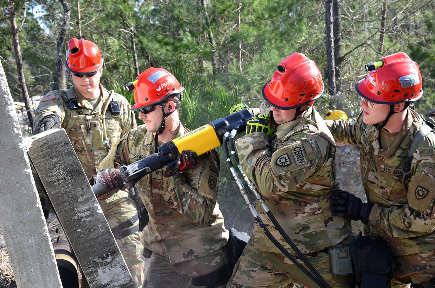 Soldiers with the Kentucky Chemical, Biological, Radiological and Nuclear Enhanced Response Force Package (CERFP)'s breech and break team use a hammer drill to extract a simulated victim from a rubble pile during an exercise evaluation at Camp Blanding, Fla., January 2019. The CERFP was tasked with responding to a 10-kiloton nuclear explosion, establishing a support zone, searching the hot zone for victims, extracting the victims from the hot zone, decontaminating the victims and providing medical assistance. Kentucky Army National Guard photo by SGT Taylor Tribble
