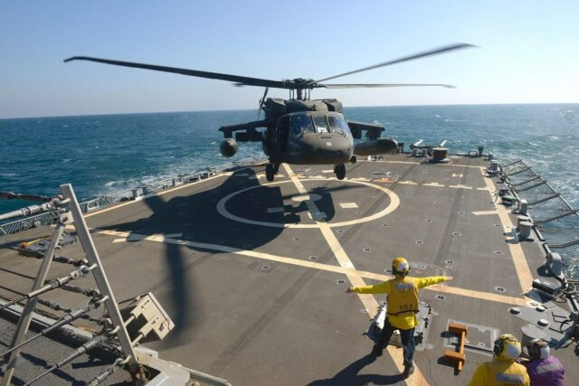 Aviators with the Minnesota, Texas and Utah National Guards, led by the Kansas National Guard's 1st Battalion, 108th Aviation Regiment, practice landing and taking off during deck landing qualification training aboard the Arleigh Burke-class guided-missile destroyer USS Mitscher (DDG 57) in the Arabian Gulf, February 2019. Minnesota Army National Guard photo by SFC Ben Houtkooper