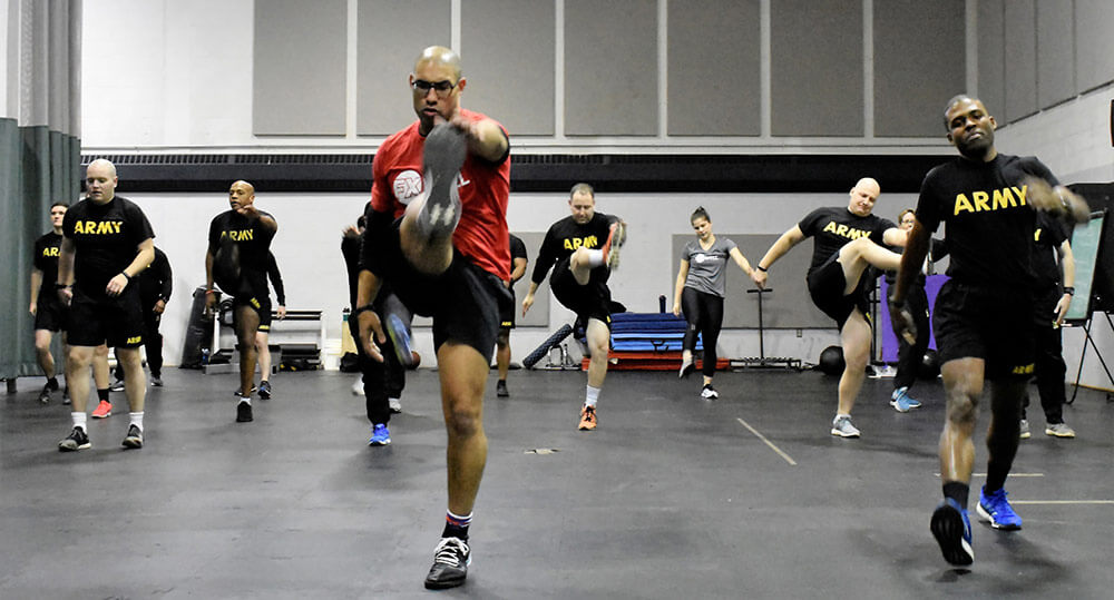 Soldiers of the 629th Military Intelligence Battalion receive instruction on proper stretching and warm-up techniques during the Fit Well fitness and physical training event held January 2019 at Camp Fretterd Military Reservation, Reisterstown, Md., as part of the battalion's preparation for the upcoming Army Combat Fitness. Maryland Army National Guard photo by MAJ Kurt Rauschenberg