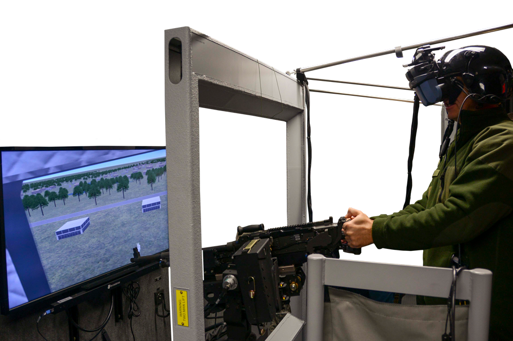 A visiting dignitary participates in a demonstration of a simulator at the National Guard's Eastern Army National Guard Aviation Training Site. Pennsylvania Army National Guard photo by SGT Zane Craig