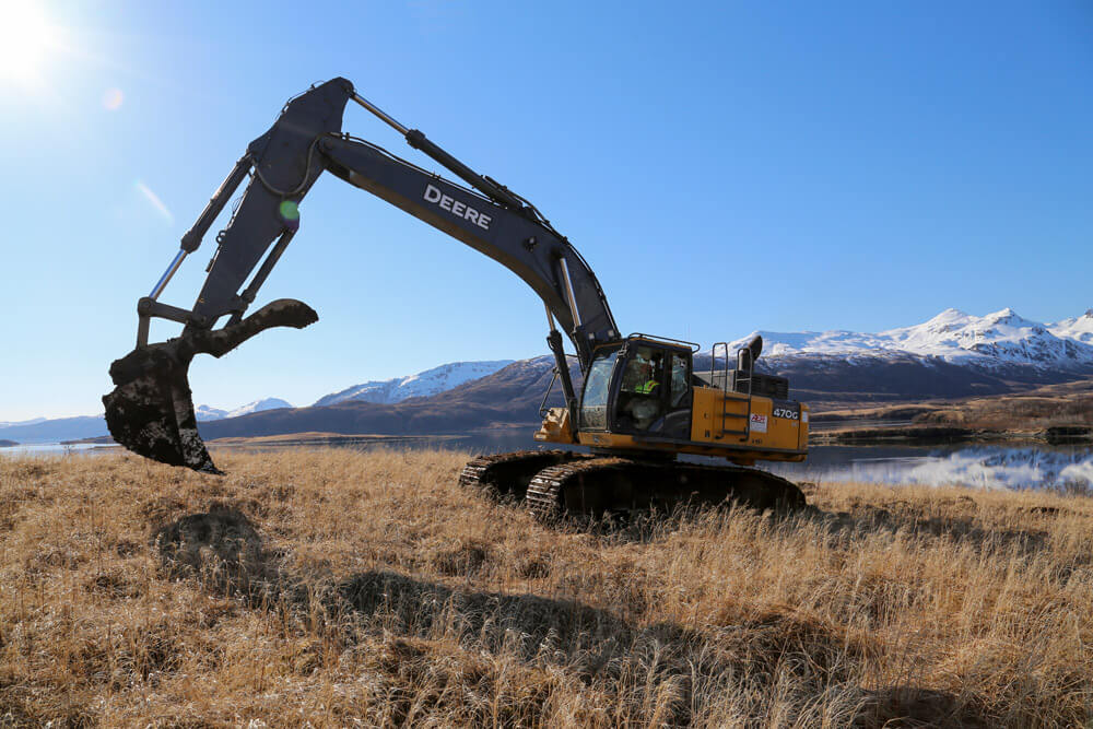 Arizona Army National Guard Soldier SPC Aaron Tellez, a motor vehicle operator with the 259th Engineer Platoon, operates an excavator during a runway extension project at Innovative Readiness Training in Old Harbor, Alaska, April 2017. Alaska Army National Guard photo by SSG Balinda O'Neal Dresel