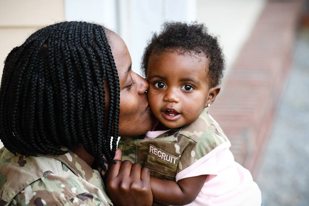 SPC ShaTyra Reed with daughter Amore Cox. U.S. Army photo by PFC Hubert D. Delany III