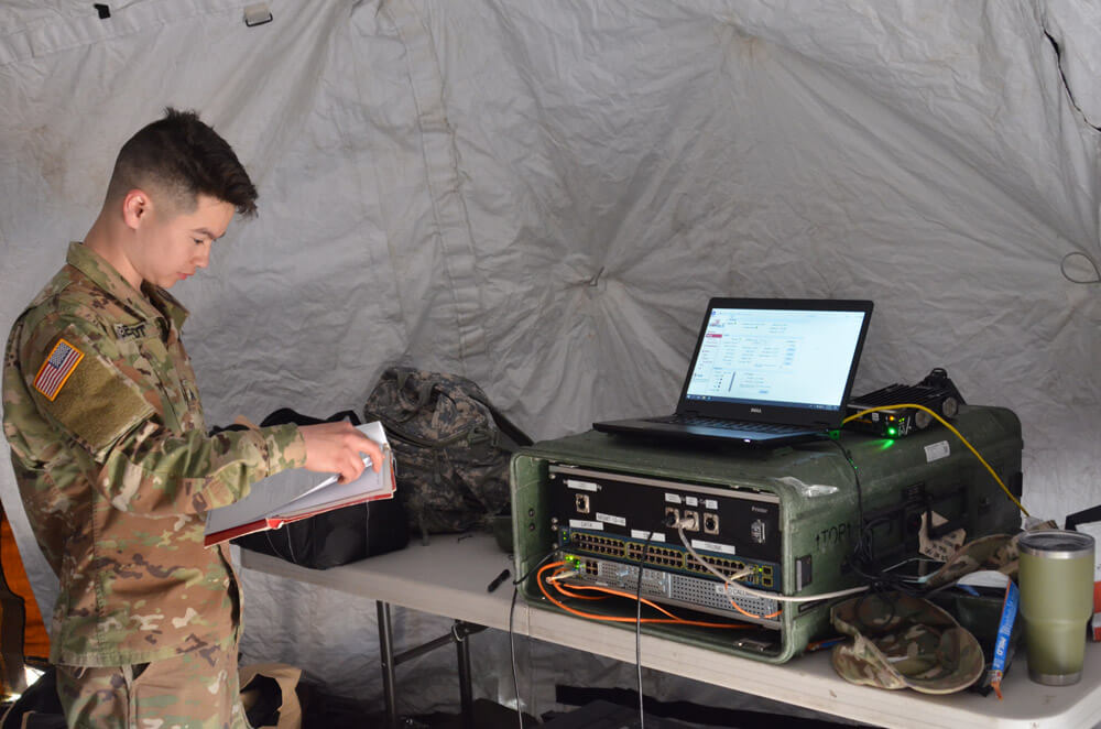 SGT Victor Berndt, a signal noncommissioned officer with the 46th Military Police Command, works to ensure the unit's satellite systems provide sustained communications capable while carrying out mission assignments during Vibrant Response 2019. Michigan Army National Guard photo by SFC Helen Miller