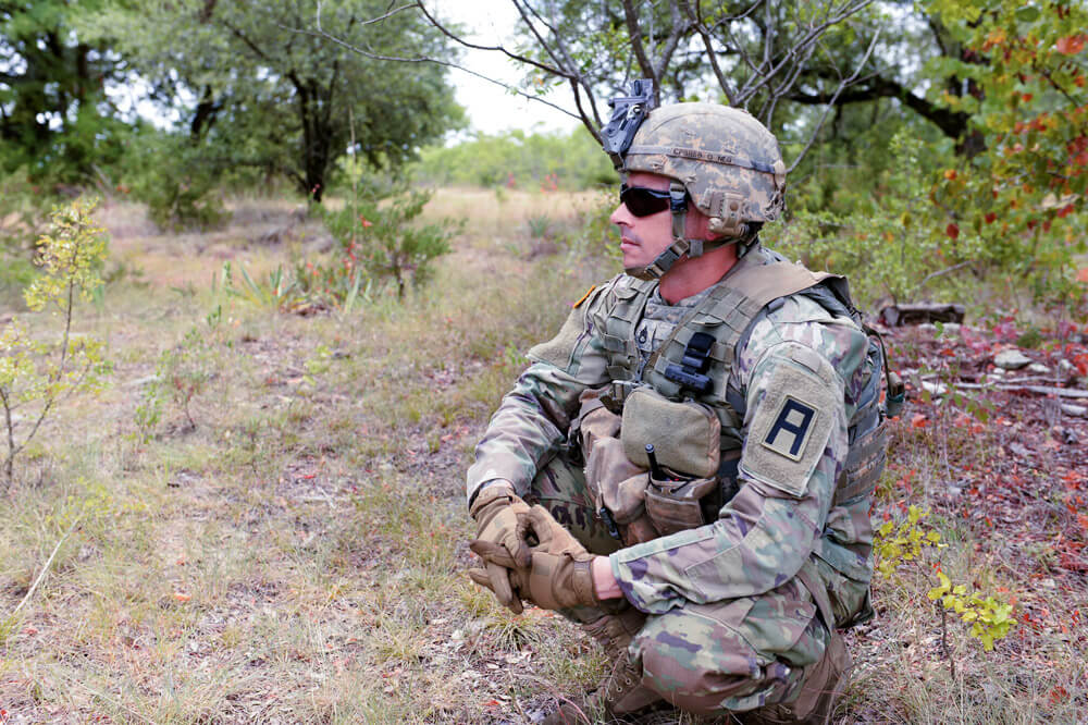 A First Army observer-coach/trainer, assigned to the 1st Battalion, 306th Infantry, works to validate Soldiers from the Tennessee Army National Guard's 2nd Battalion, 278th Armored Brigade Combat Team, before the unit's then-upcoming deployment. U.S. Army photo by Devon L. Suits