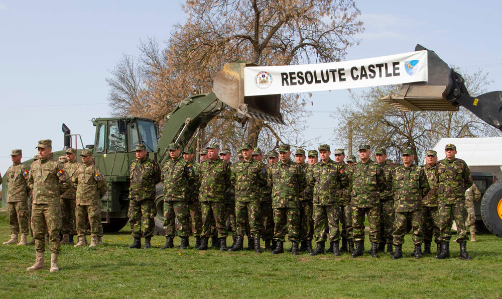 Romanian Land Forces service members stand in formation during the opening ceremony of Resolute Castle 19, a multilateral engineer training exercise supporting Atlantic Resolve and allied interoperability, at Cincu Joint National Training Center, Romania, April 2019. U.S. Army photo by SSG True Thao