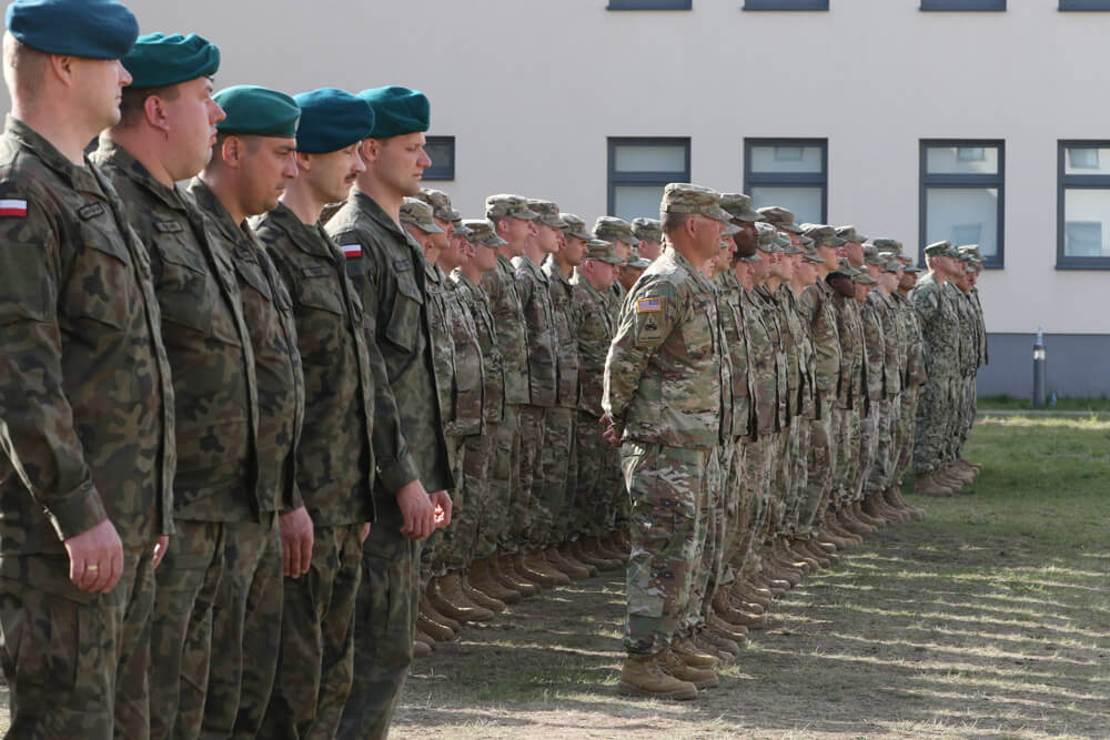 Polish and U.S. service members stand in formation during the opening ceremony of Resolute Castle 19, a multilateral engineer training exercise supporting Atlantic Resolve and allied interoperability, at the Drawsko Pomorskie Training Area, Poland, April 2019. U.S. Army photo by PVT Caleb Minor