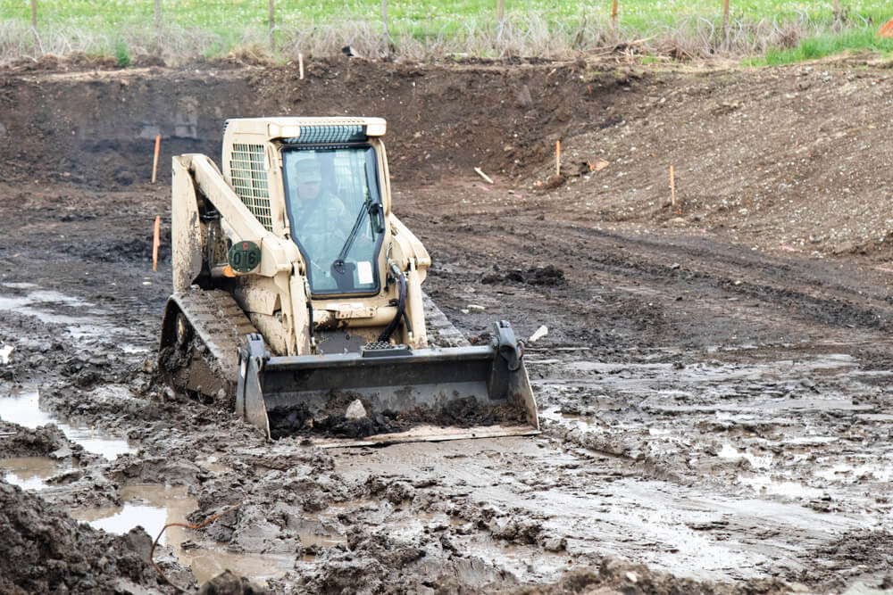 SSG Sean Robles, 207th Engineer Utility Detachment, Alaska Army National Guard, operates a grader on one of the work sites at Land Forces Combat Training Center Getica, Cincu, Romania, as part of exercise Resolute Castle 19, May 2019. Alaska Army National Guard photo by PVT Grace Nechanicky