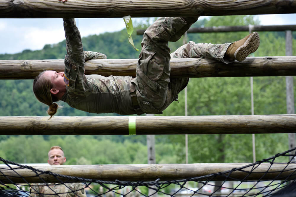 SSG Cassandra Black maneuvers up a Jacob's ladder during the obstacle course portion of the 2019 Region II Best Warrior Competition.