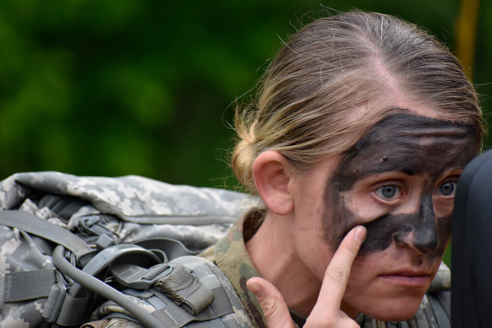 SSG Cassandra Black dons face paint in preparation for field exercises during the 2019 Region II Best Warrior Competition.