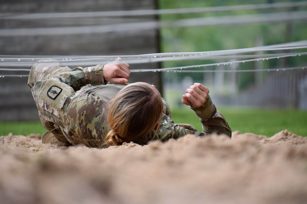 SSG Cassandra Black moves through the low-crawl segment of the obstacle course event as part of the Region II Best Warrior Competition, May 2019.