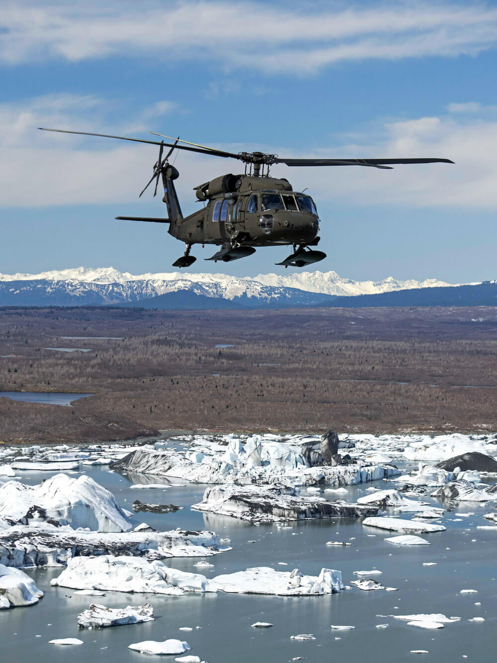 A 207th Aviation Battalion Alaska Army National Guard UH-60 Black Hawk makes a cross-country training flight from Anchorage to Juneau, Alaska, April 26, 2019. Alaska Army National Guard photo by 1LT Benjamin Haulenbeek