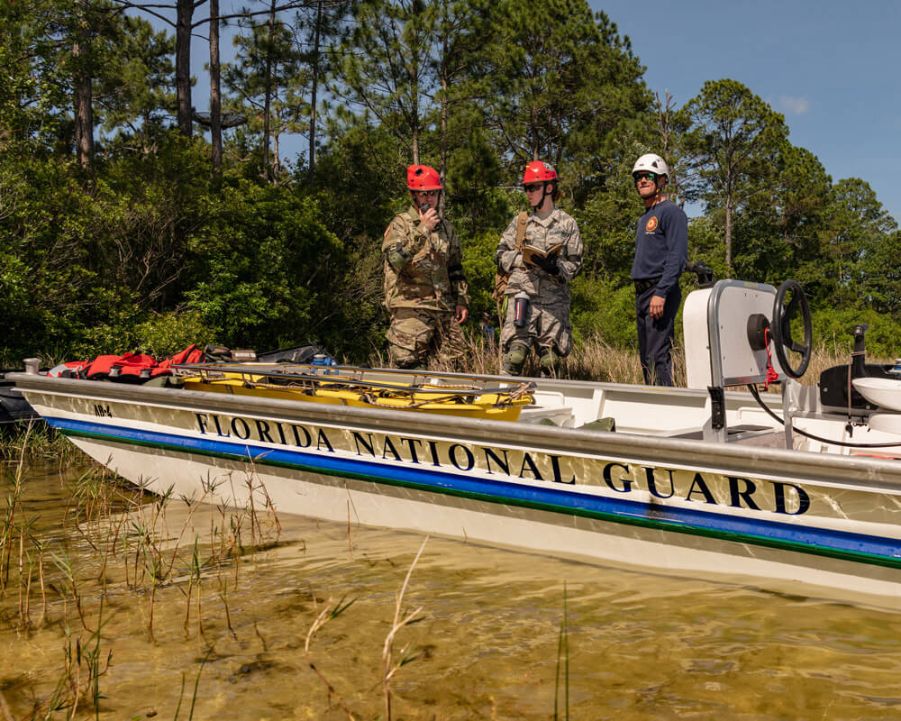 A task force team comprised of Florida Army National Guard Soldiers and Florida civilian first responders rehearse a maritime rescue at Kingsley Lake on Camp Blanding Joint Training Center as part of the annual Search and Rescue Exercise. Florida National Guard photo by Ching Oettel