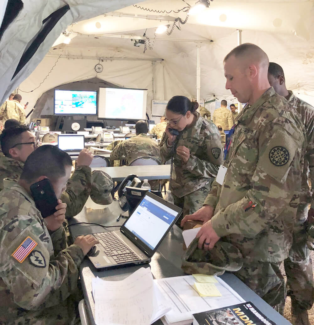 Soldiers of the 369th Sustainment Brigade, New York Army National Guard, man their command post during exercise Guardian Response 19 at Camp Atterbury, Ind., May 2019. New York Army National Guard photo by SGT Deyanira Rios