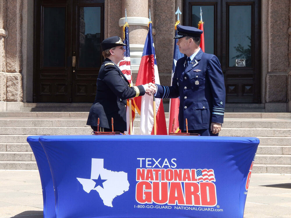 Adjutant General of Texas MG Tracy Norris shakes hands with a Chilean military official at the Texas State Capitol in Austin, Texas, April 12, 2019, during a celebration of the ongoing State partnership between Chile and Texas. Texas National Guard photo by Brandon Jones
