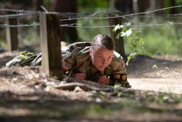SPC Marina Grage, HHC, 890th Engineer Battalion, Mississippi National Guard, takes part in an obstacle course competition at Camp Butner, N.C., during Region III Best Warrior Competition on May 15, 2019. The five-day competition consists of tests of physical and mental endurance that include physical fitness, army warrior tasks and drills, land navigation, a road march, weapon qualification, a stress shoot course, urban operations, and the Noncommissioned Officer/Soldier review board. Alabama Army National Guard photo by SSG William Frye